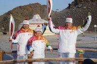 Свой путь по Туве Олимпийский огонь начал у священного Оваа, посвященного горловому пению